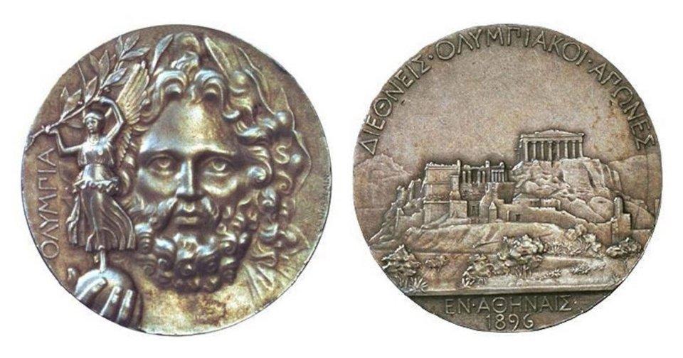 Переможцям Олімпіади давали срібну або мідну медаль із зображенням Зевса та афінського Акрополя, оливкову гілку та диплом / Olympic.org